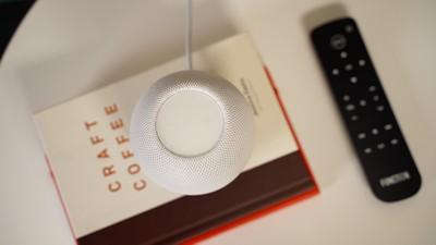 homepod mini on a book