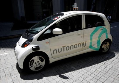 A nuTonomy self-driving taxi drives on the road in its public trial in Singapore