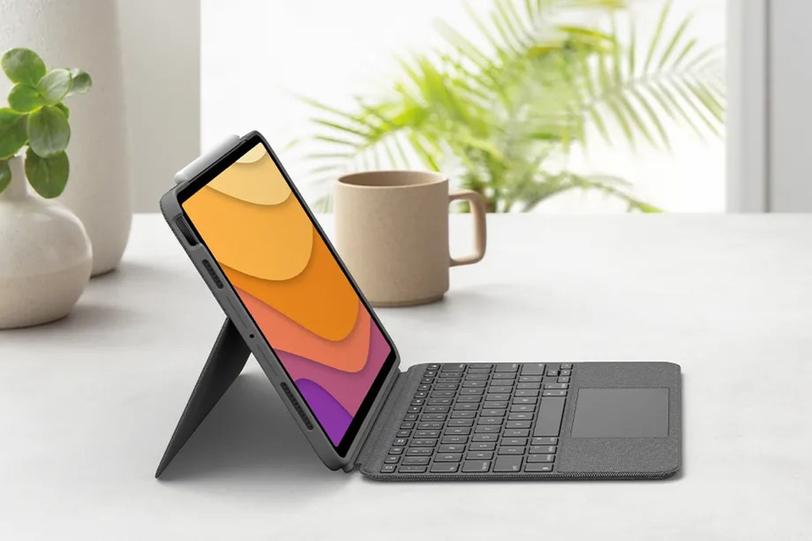 photo of Logitech Combo Touch Keyboard and Trackpad Case for 4th-Gen iPad Air Now Available for Pre-Order, Ships in July image