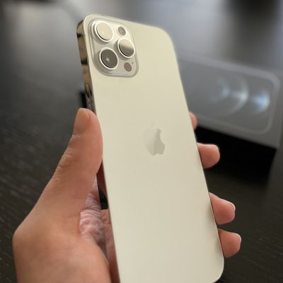 iphone 12 pro max gold in hand