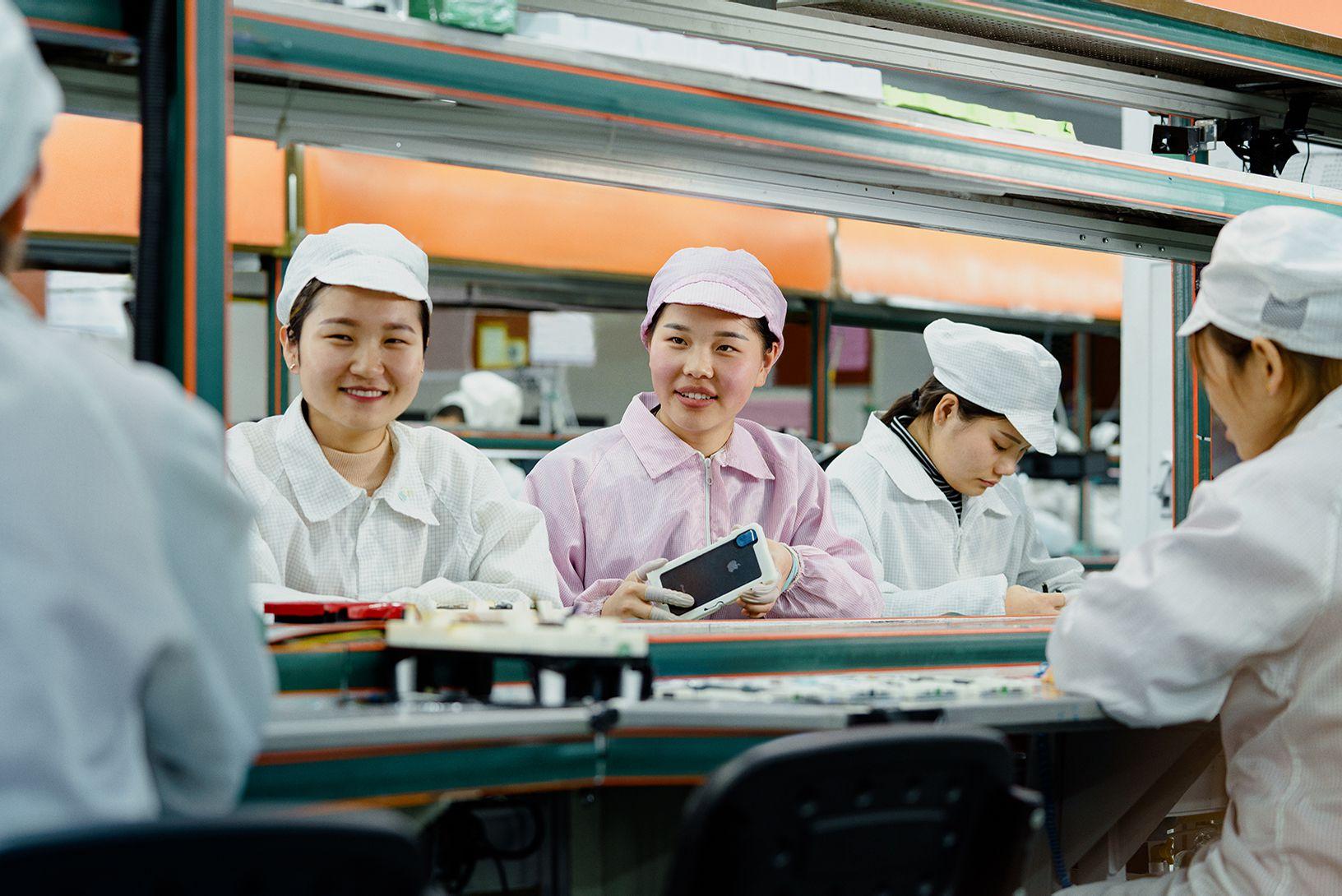 Apple SR Report 2019 women assembly iphone 03062019 big jpg large 2x.'