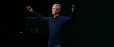 tim cook hands raised